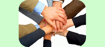 Teamwork Image Showing Stacked Hands